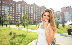 Beautiful girl portrait holding apple. eating fruit. Closeup beautiful girl portrait holding apple. eating fruit stock photography