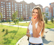 Beautiful girl portrait holding apple. eating fruit. Closeup beautiful girl portrait holding apple. eating fruit royalty free stock image
