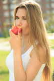Beautiful girl portrait holding apple. eating fruit Stock Photography