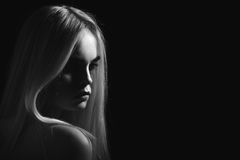 Beautiful girl portrait. With long blond hair monochrome stock images