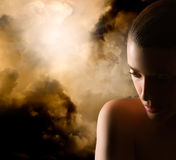 Beautiful Girl Portrait. Mistery Woman. Closeup of beauty young woman. Dark portrait at sunset Royalty Free Stock Image