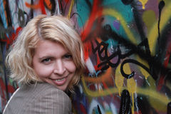 Beautiful girl portrait with normal skin isolated against graffiti wall Royalty Free Stock Photography