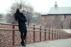 Beautiful girl portrait in a park. Full length royalty free stock image