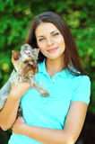 Beautiful girl portrait with puppy yorkshire terrier Stock Photography