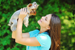 Beautiful girl portrait with puppy yorkshire terrier Stock Photo