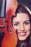 Beautiful girl portrait with a fiddle Royalty Free Stock Images