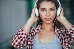 Beautiful girl portrait wearing headphones. Stock Photos