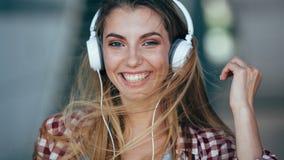 Beautiful girl portrait wearing headphones. Stock Images