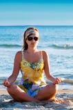 Beautiful girl in pose of lotus Stock Photos