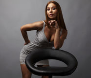 Beautiful girl pose near stylish armchair. Photo. Royalty Free Stock Photography