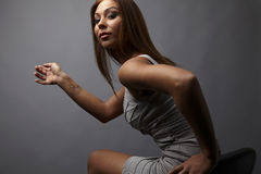 Beautiful girl pose near stylish armchair. Photo. Stock Images