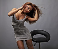 Beautiful girl pose near stylish armchair. Photo. Royalty Free Stock Photo