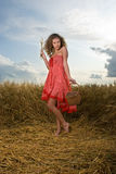Beautiful girl pose in wheat field with basket Stock Photo