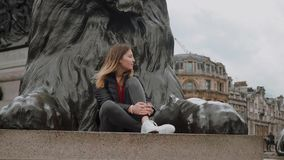 Beautiful girl poses for a photo in the city of London stock video footage