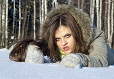 The beautiful girl poses on the snow. In nature Royalty Free Stock Images
