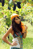 Beautiful girl poses in a vineyard Royalty Free Stock Images
