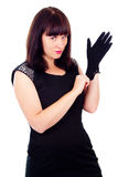 Beautiful girl poses, wears gloves Stock Image