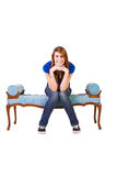 Beautiful Girl Posing on the Antique Couch Royalty Free Stock Photo