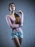Beautiful Girl. Posing on a background royalty free stock images