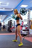 Beautiful girl posing with barbell during workout Royalty Free Stock Photo