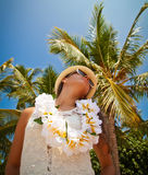 Beautiful girl posing on the beach in the hot sun, outdoor portr Royalty Free Stock Images