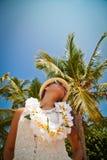Beautiful girl posing on the beach in the hot sun, outdoor portr Stock Photos