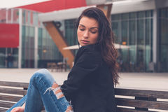 Beautiful girl posing on a bench Royalty Free Stock Photo