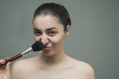 Beautiful girl posing with a big cosmetic brush. Stock Photo