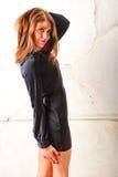 Beautiful girl posing in black silk dress Royalty Free Stock Images