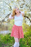 Beautiful girl posing in blooming tree on nature Royalty Free Stock Photos