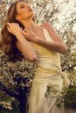 Beautiful girl  posing at the  blossom park Royalty Free Stock Photo
