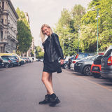 Beautiful girl posing in the city streets Stock Image