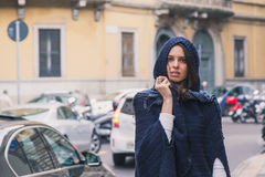 Beautiful girl posing in the city streets Stock Images