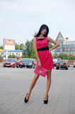Beautiful girl posing on city streets Royalty Free Stock Photography
