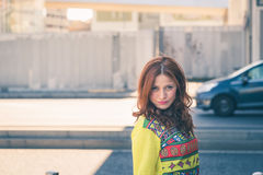 Beautiful girl posing in the city streets Royalty Free Stock Photography