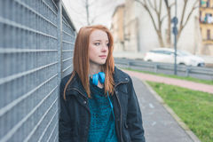 Beautiful girl posing in the city streets Stock Photography