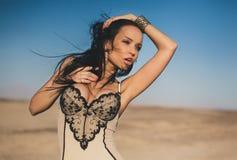 Beautiful girl posing in a desert Royalty Free Stock Image