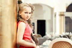 Beautiful girl posing in elegant dress with mask Stock Image