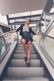 Beautiful girl posing on an escalator Stock Image