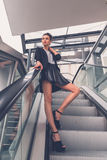 Beautiful girl posing on an escalator Royalty Free Stock Photography