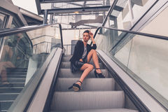 Beautiful girl posing on an escalator Stock Images