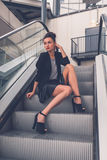 Beautiful girl posing on an escalator Royalty Free Stock Photo