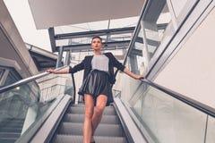 Beautiful girl posing on an escalator Stock Photo