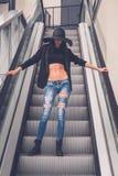 Beautiful girl posing on an escalator Stock Image
