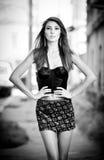 Beautiful girl posing fashion near red brick wall Stock Image