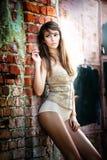 Beautiful girl posing fashion near red brick wall Stock Photography