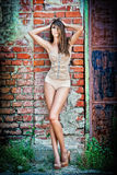 Beautiful girl posing fashion near red brick wall. On the street .Summer in the city - fashion urban girl Royalty Free Stock Photo