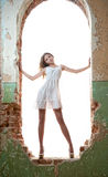 Beautiful girl posing fashion in a window frame Royalty Free Stock Photography