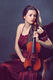 Beautiful girl posing with a fiddle Stock Photo