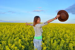 Beautiful girl posing in a field of yellow flowers Royalty Free Stock Image